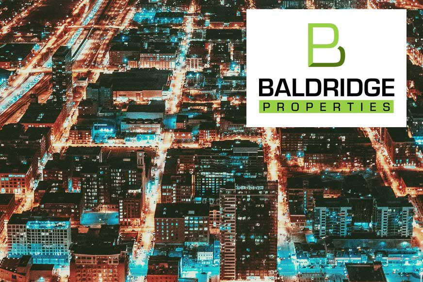 Arial View of Cityscape where  you may Consider a Land Lease for your Commercial Rental Property | Baldridge Properties